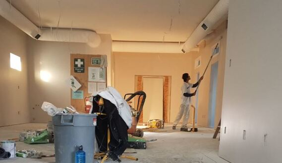 Commercial Painter painting the interior of office building